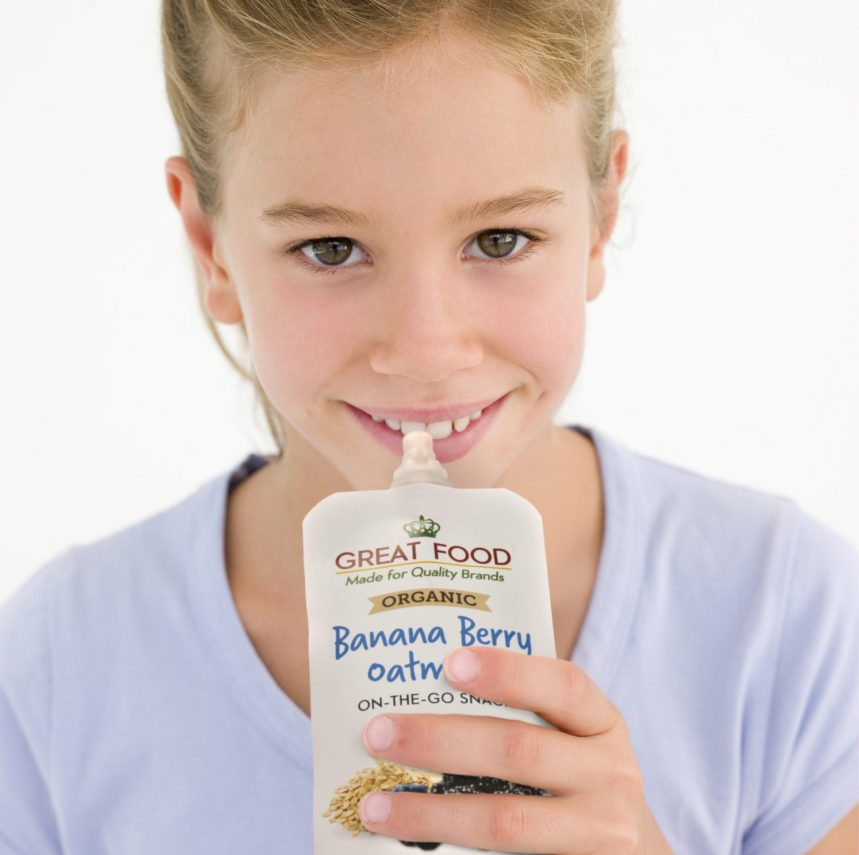 Young girl with glass of milk smiling